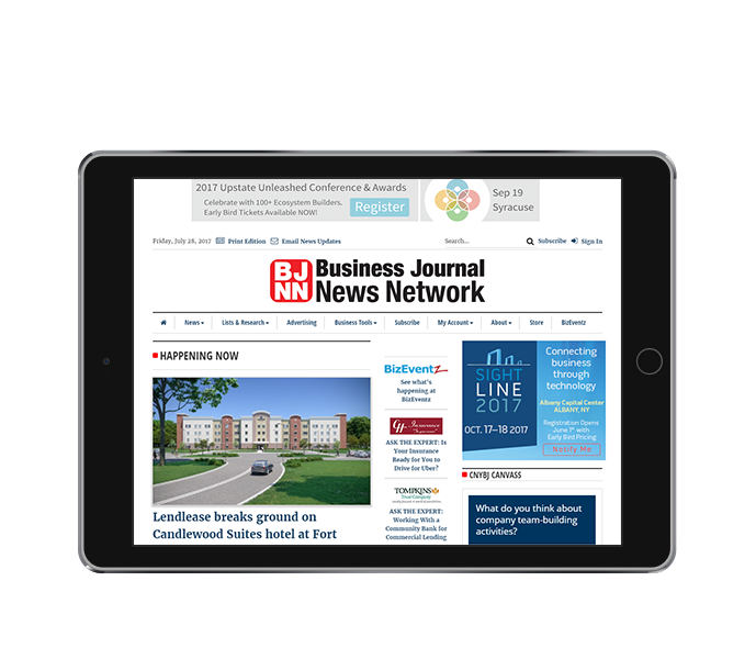 news website design tablet landscape view of cny business journal from acs inc web design and seo